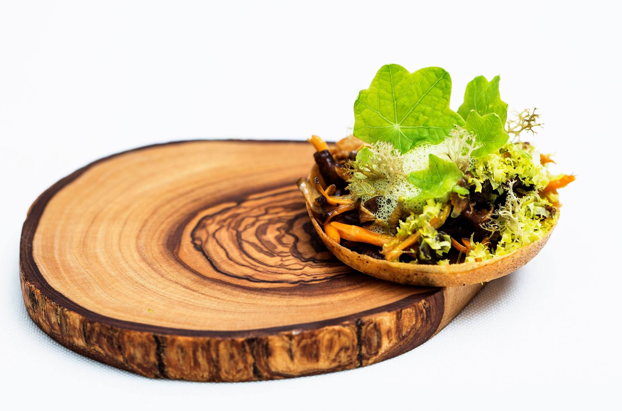 Chanterelle tartelette with nasturtium and pistacci